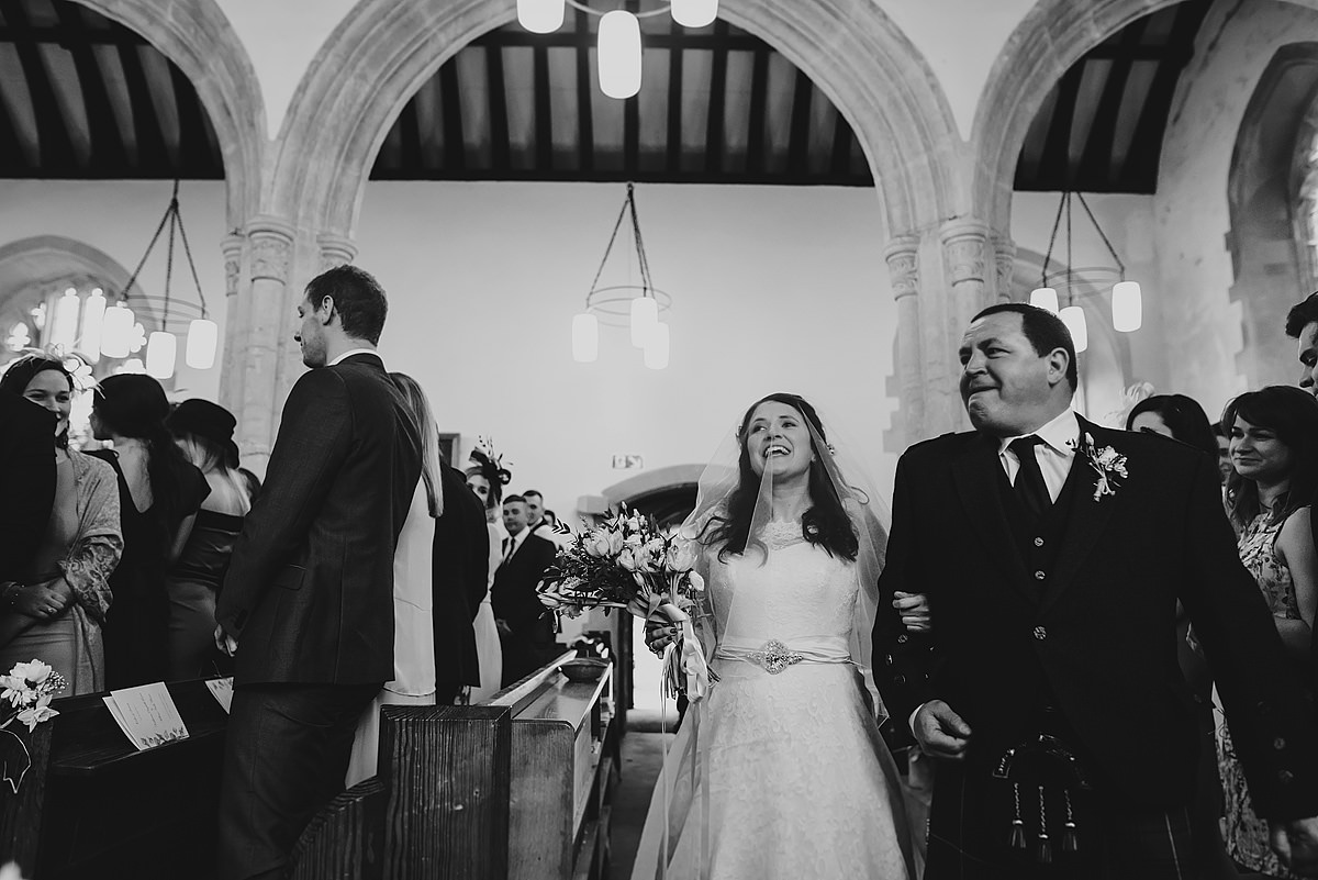 Bride and dad walking up the isle at Georgeham Church