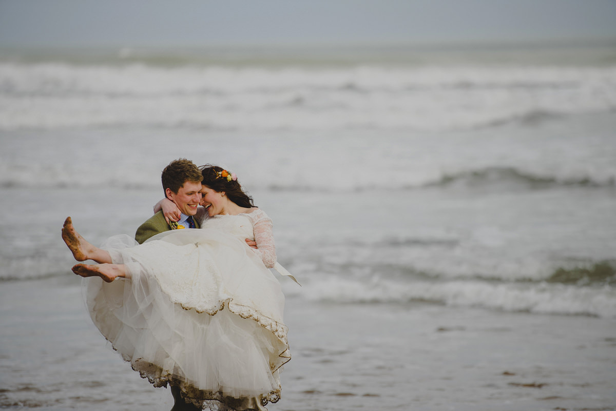 Bride and groom at Putsborough Beach