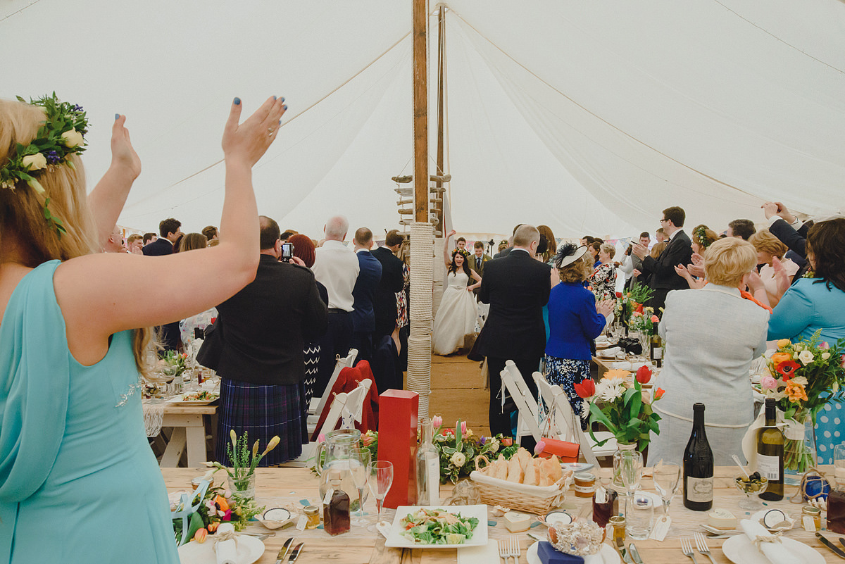 Bride and groom enter marquee at a Croyde wedding