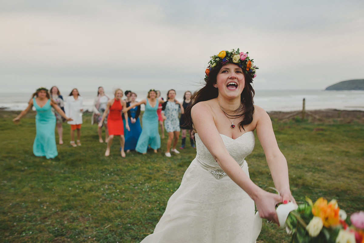 Bride throwing bouquet in Croyde