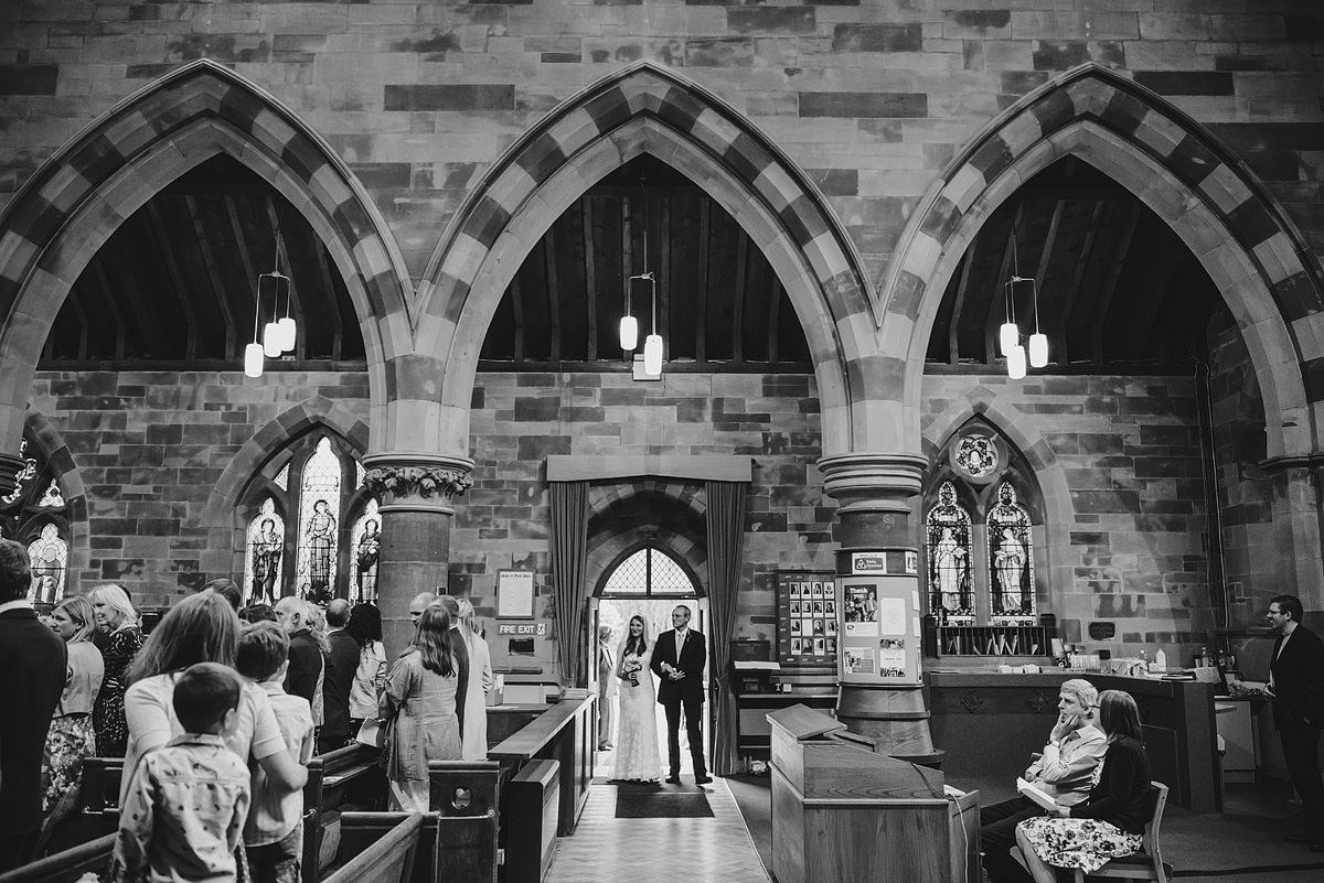 Bride entering Holy Trinity church with father