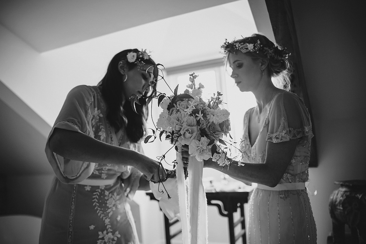 Bridesmaid helping bride at an Anran wedding