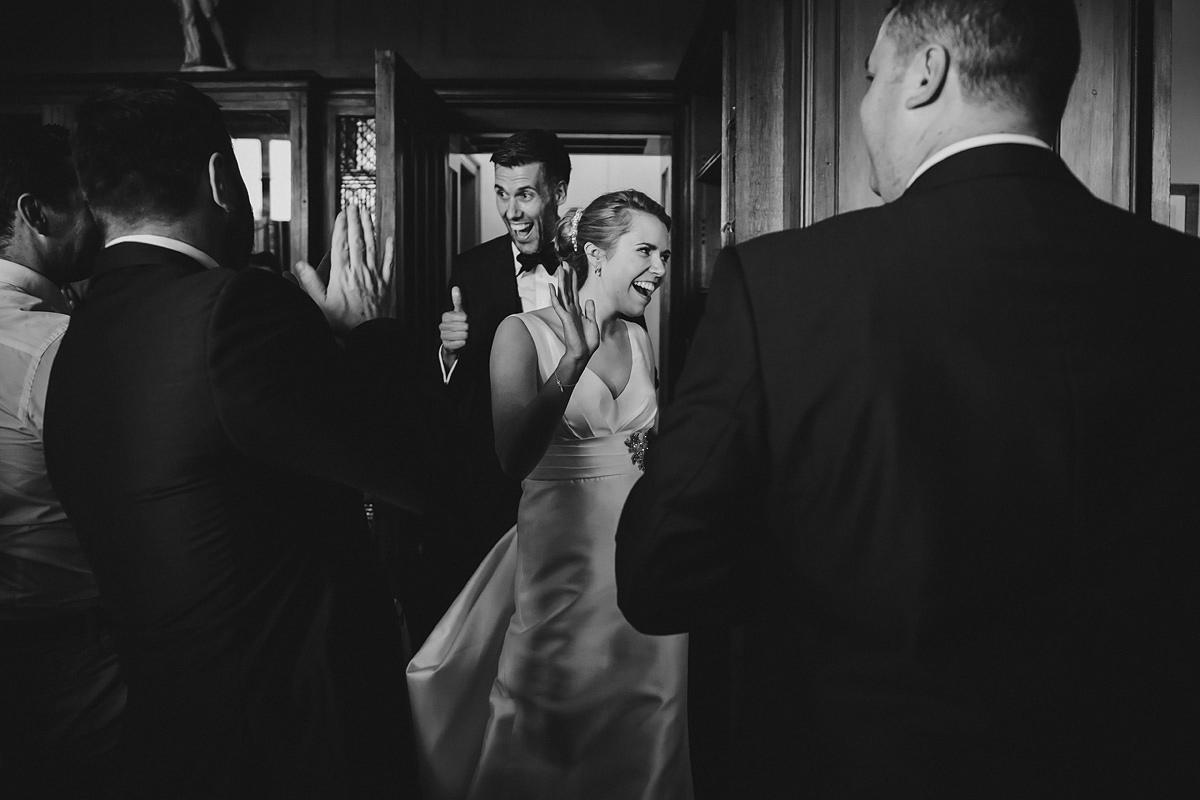 Bride and groom entering wedding breakfast