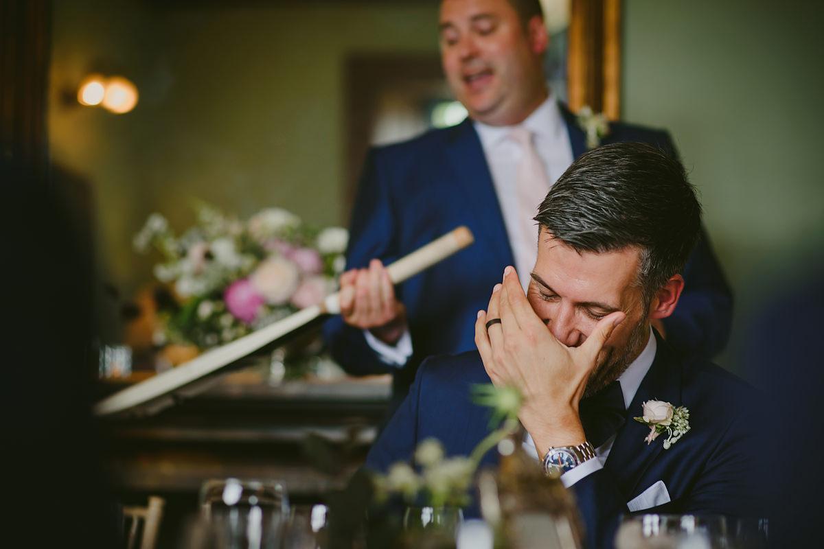 Groom reaction to best man speech