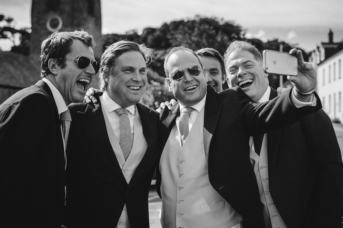Groomsmen selfie before ceremony