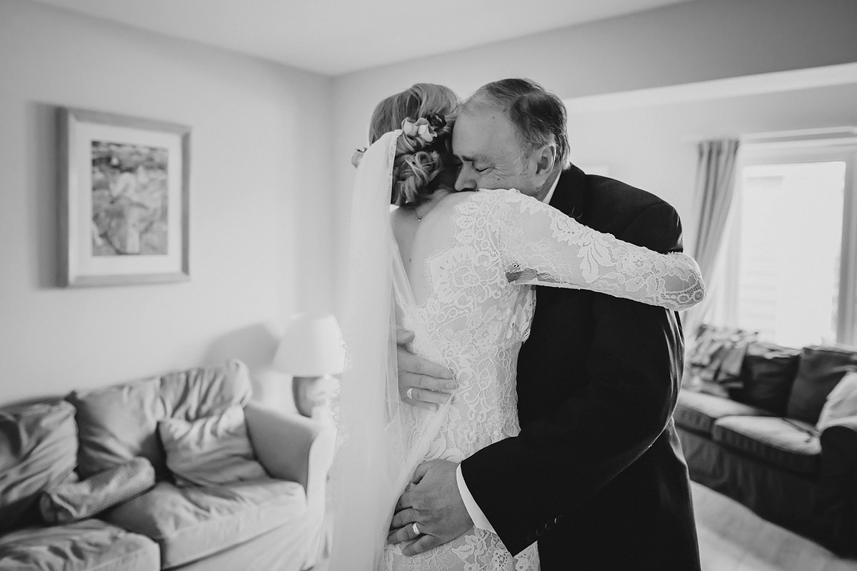 Dad and bride hug before ceremony