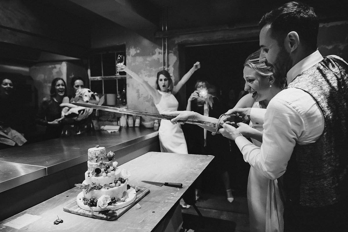 Cate cutting at an Anran wedding