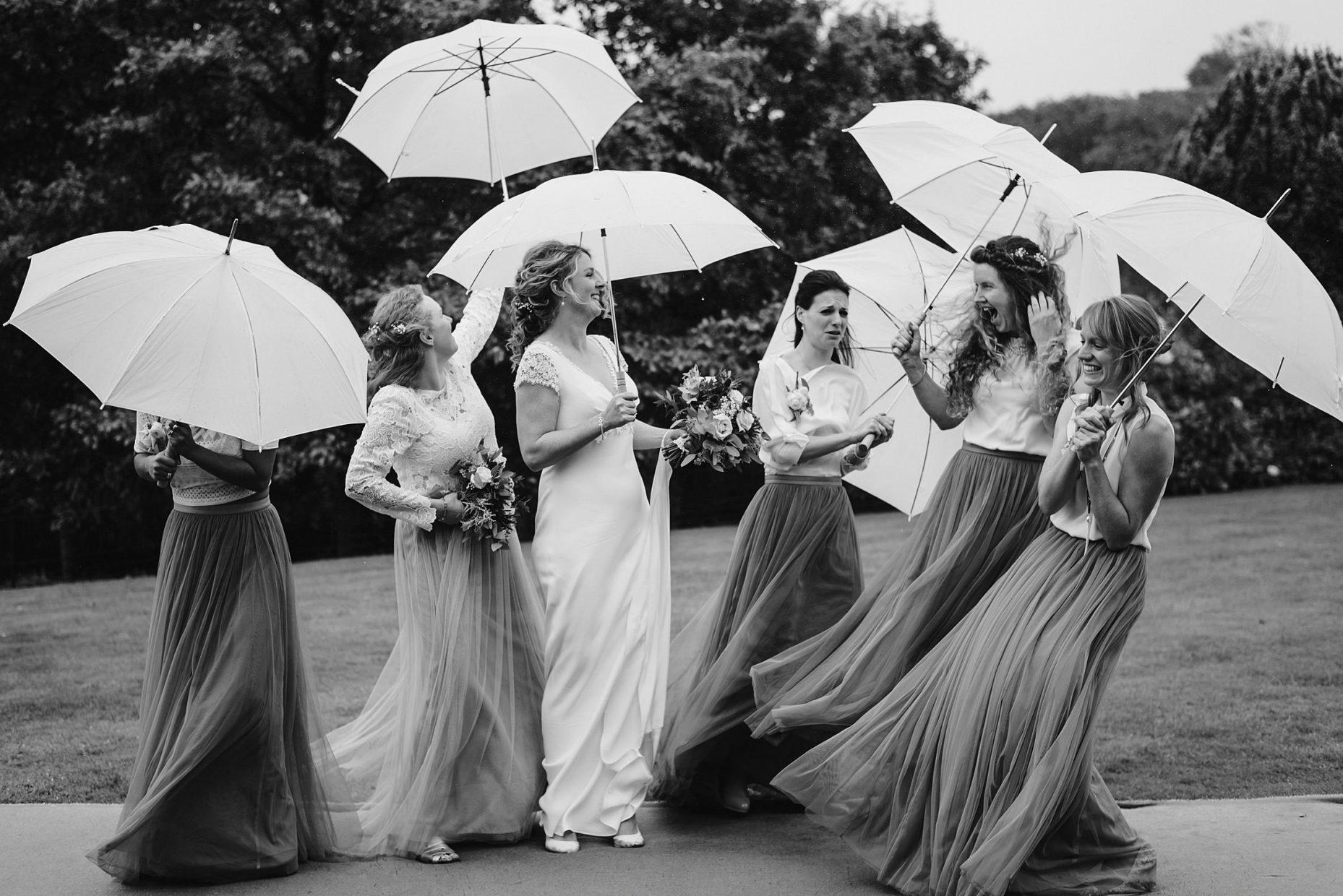bridesmaids umbrella wedding photo