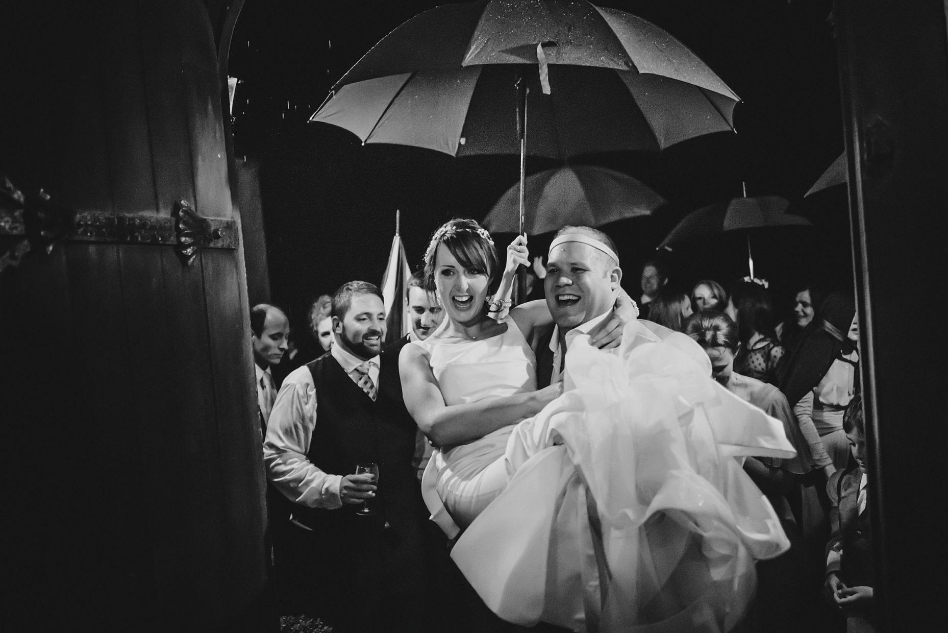 fun rainy wedding photos cornwall