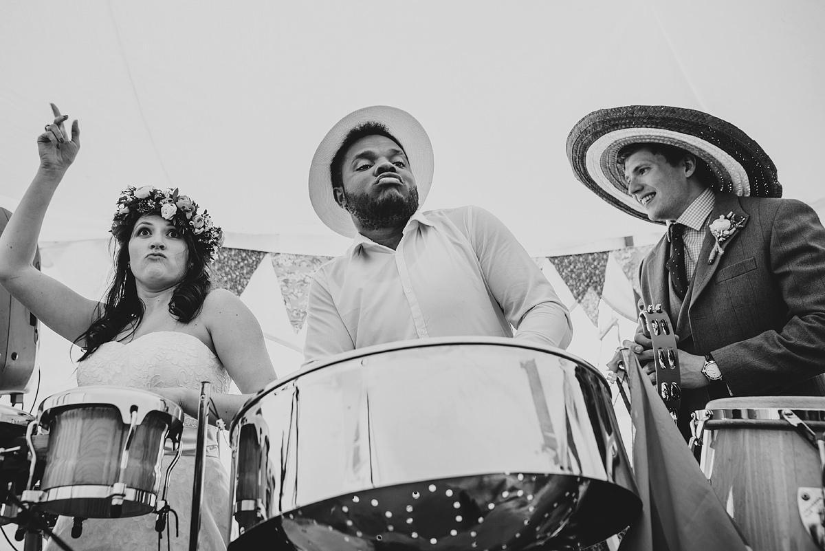 Bride and groom playing drums in Croyde