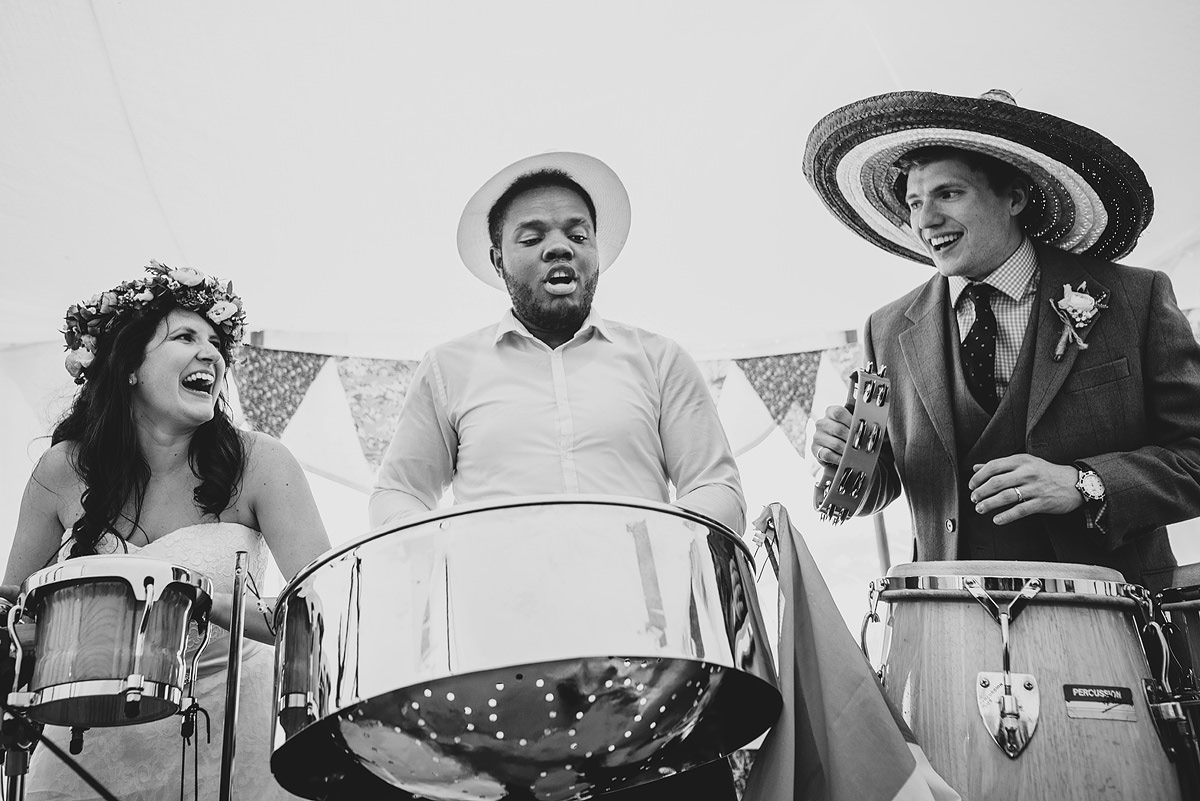 Bride and groom playing drums