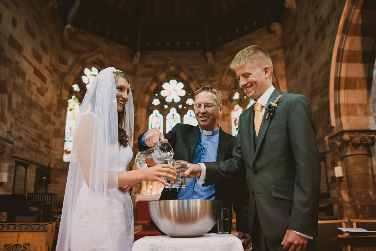 Bride and groom blessing at Holy Trinity Church