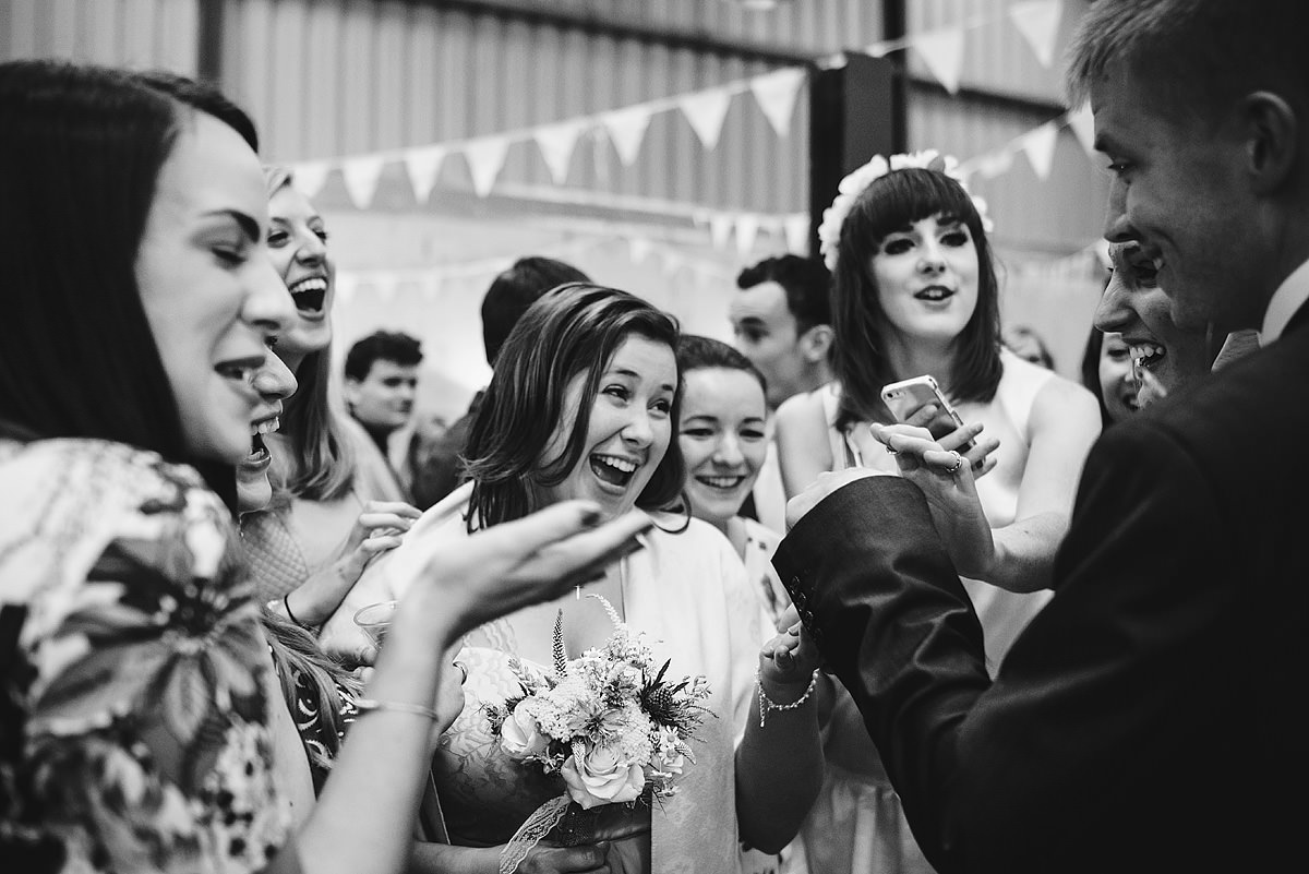 Guests having fun at barn wedding reception