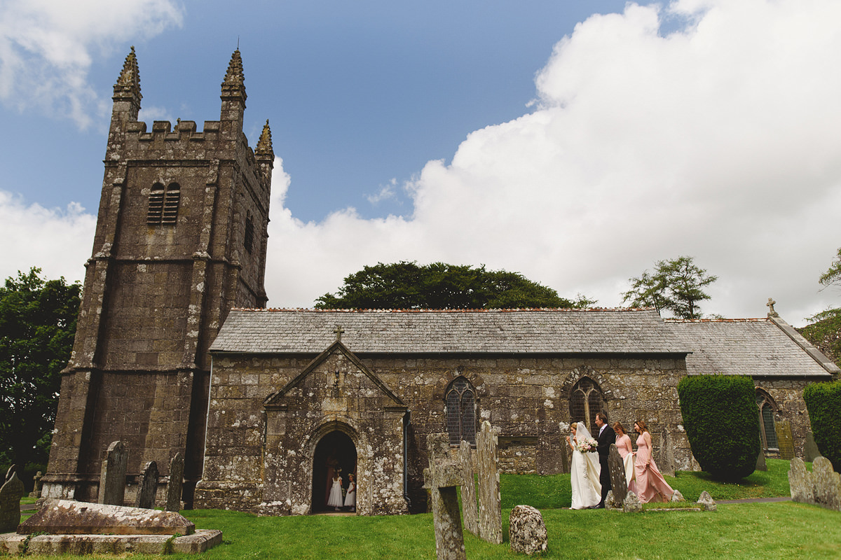 Bride arriving at Lydford Church for ceremony