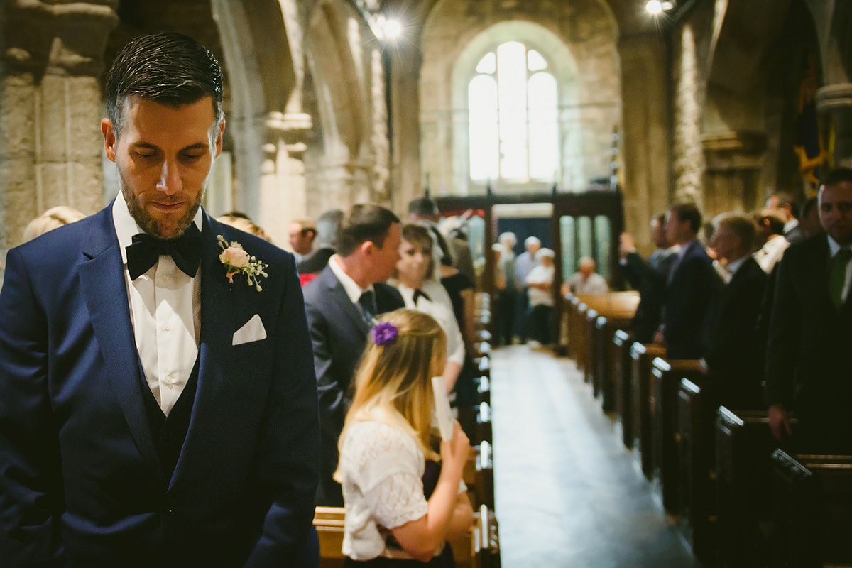 Groom waiting for bride at Lydford Church in Devon