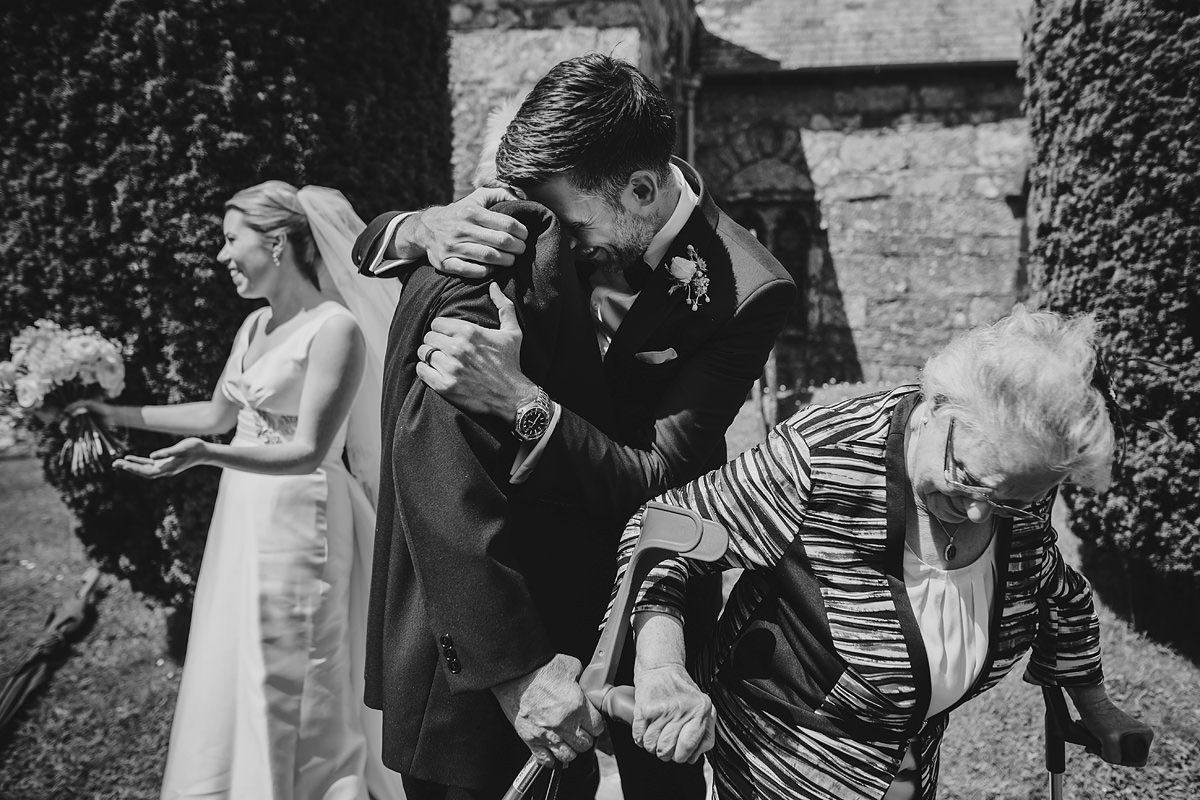 Emotional hug with groom's grandad
