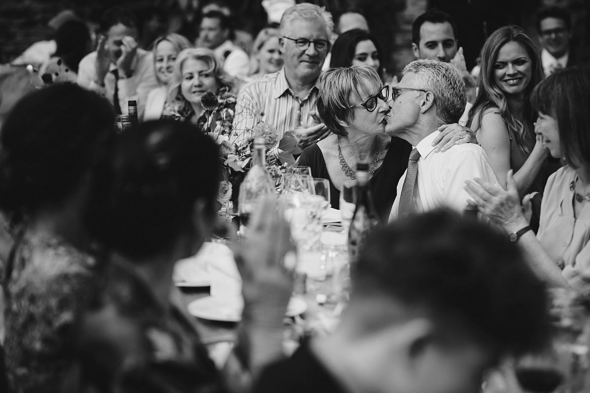 Guests kissing during speeches