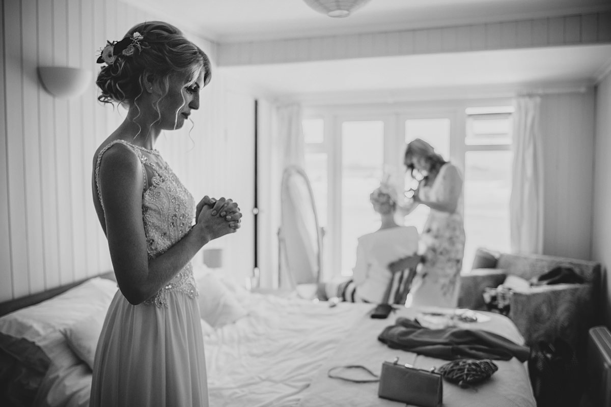 Bride getting ready at Lusty 's beach cottage