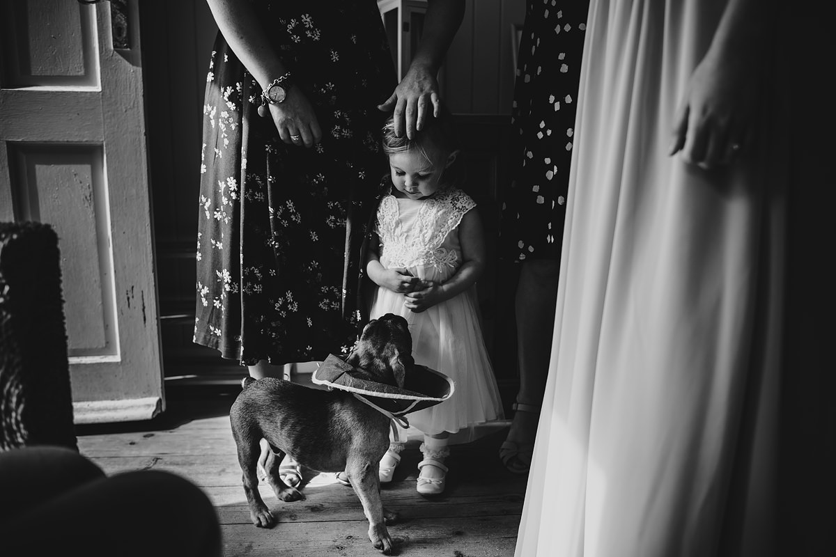 Flower girl and dog at Lusty Glaze cottage