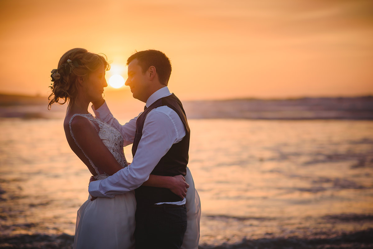 Bride and groom sunset photo