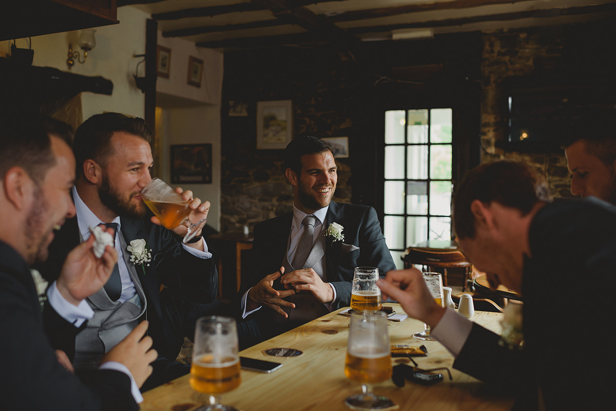 Groom having drinks at the pub
