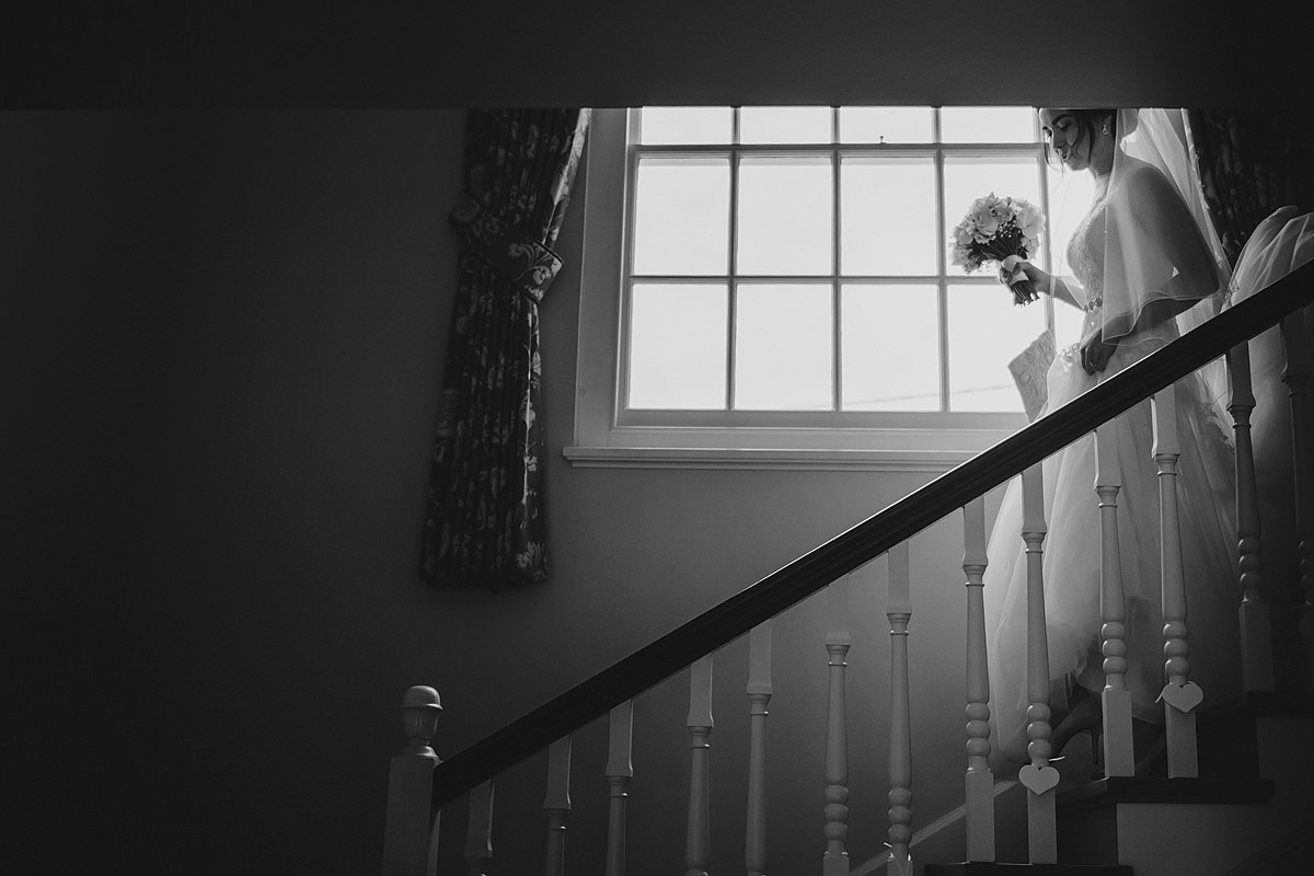 Bride coming down stairs at Pamflete House