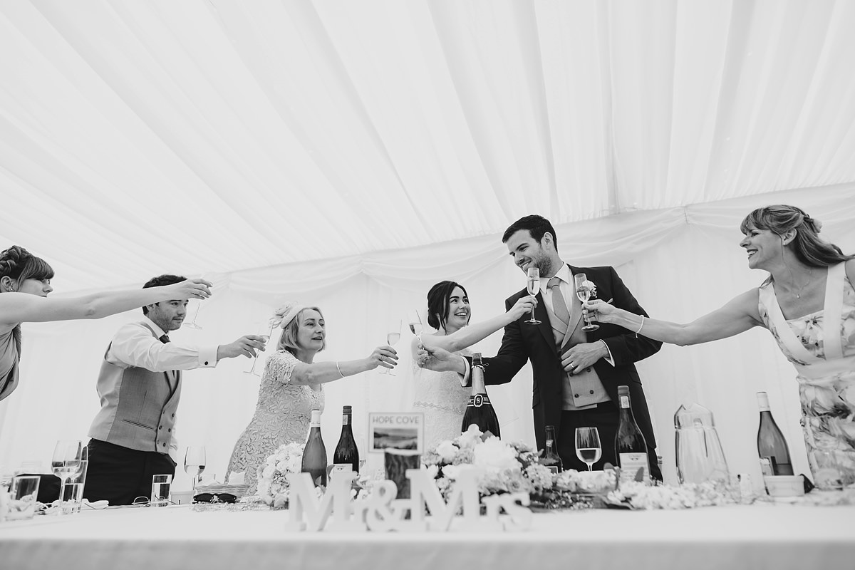 Wedding toast in marquee at Pamflete House