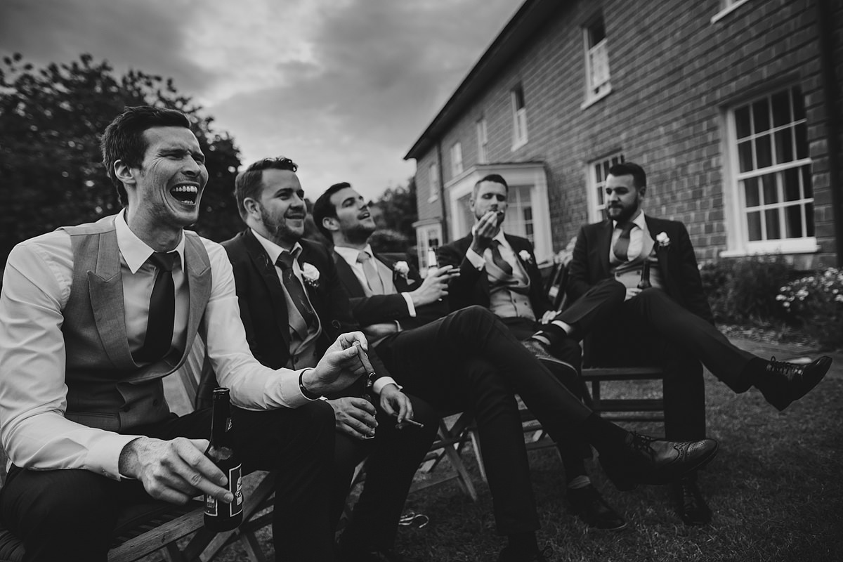 Groom and ushers smoking cigars