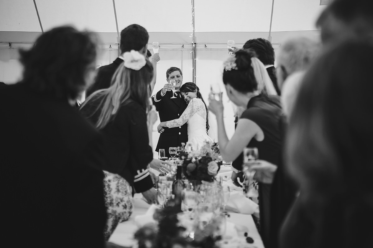 groom giving toast during speeches
