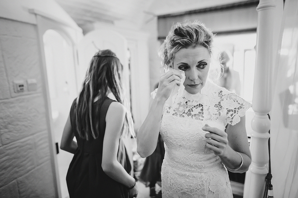 Emotional bride before her ceremony at Polhawn Fort