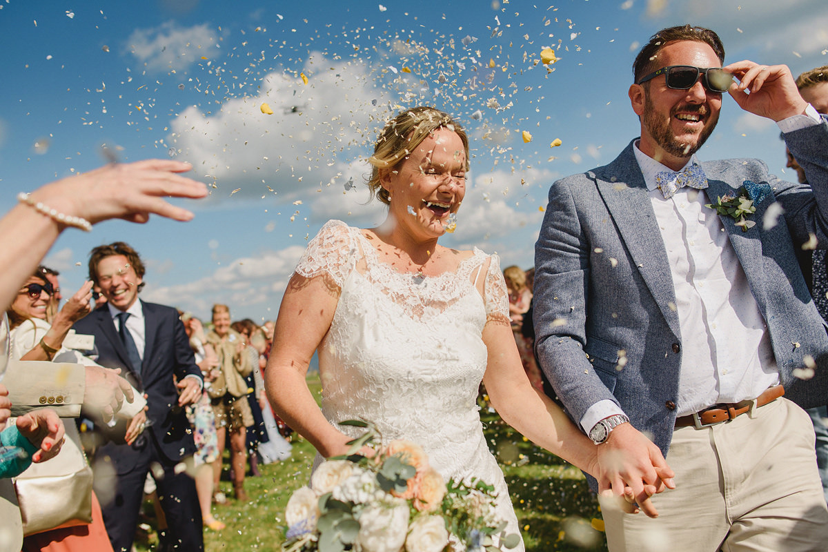 Bride and groom confetti photo