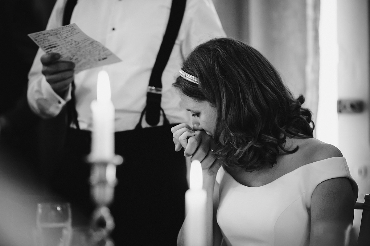 Emotional bride during speeches at Endsleigh Court