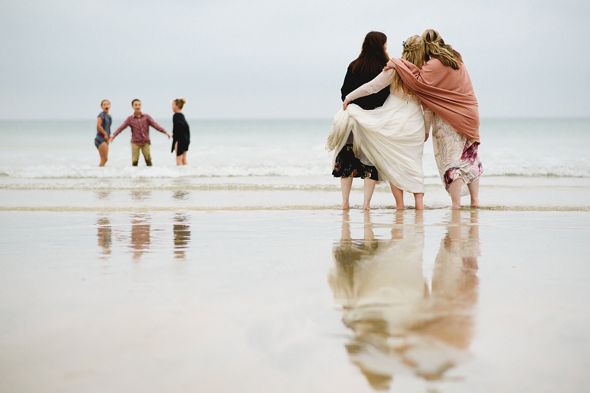 Bride and bridesmaids at Lusty Glaze beach